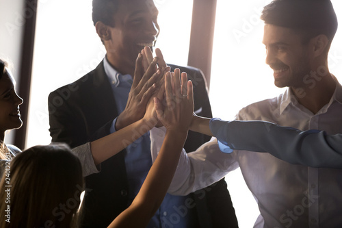 Happy diverse business team people employees give high five