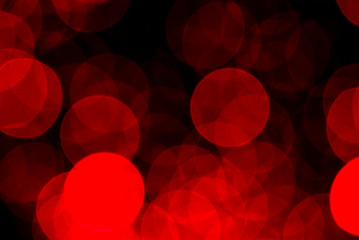 Blurry red light circles glowing in the dark
