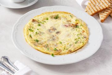 Omelette, fried eggs for breakfast