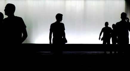 Silhouettes of young  people walking in motion blur in the night