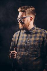 Stylish beard man in glasses and checked shirt smoking hookah at night bar.close eup shot. isolated black background. studio shot. free time. lifestyle