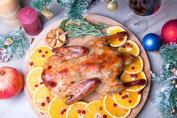Christmas duck with oranges and cranberries whole baked. Close-up, selective focus.