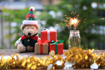 Selective focus of sparklers and gift box for Christmas and New Year's Day or Greeting season