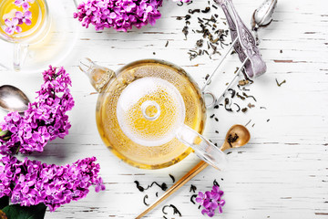 Wall Mural - Cup of tea and lilac flowers