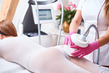 Woman White Suit Getting Anti Cellulite massage