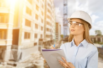 Beautiful woman engineer  with document