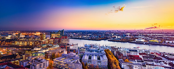 "Panoramic aerial view of the harbor district, the concert hall ""Elbphilharmonie"" and downtown Hamburg, Germany, at dusk."