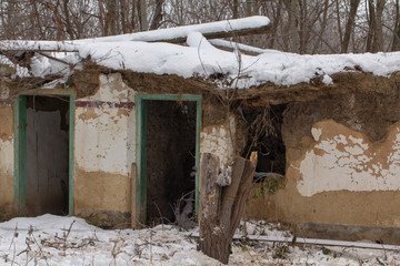 Old abandoned rural house, with signs of destruction from lack of care