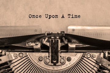 once upon a time printed on a sheet of paper on a vintage typewriter. writer, journalist.