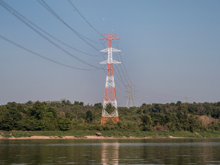 An overland high-voltage line crosses the Mekong near Pakse, Laos.
