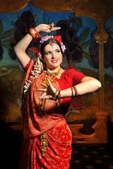 Photo of a woman in red in indian style.