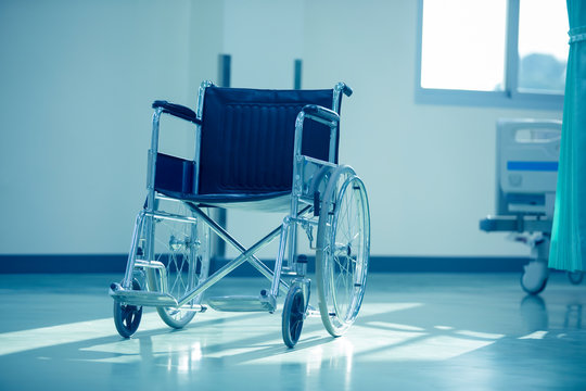 Wheel Chair,Empty wheelchair in the hospital,Wheelchair parked beside the patient bed