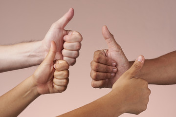 Hands together doing thumbs ups