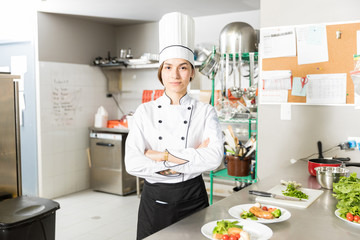 Beautiful Cook Standing In Commercial Kitchen