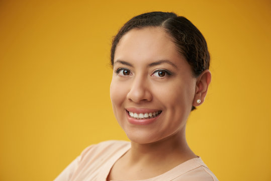 Latina headshot color background