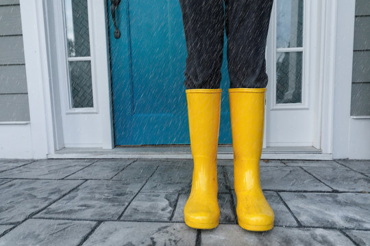 Yellow Wellies  Rainboots Outside on the wet Porch while raining