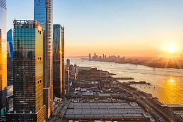Wall Mural - Aerial New York City waterfront skyline at sunset viewed from Hudson Yards towards Jersey City accross Hudson River.