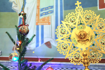 The Orthodox Church. Ripid on the background of the icon and  Christmas trees during the Christmas liturgy