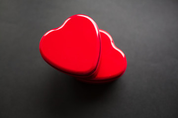 Valentines day concept. Red hearts on black background.