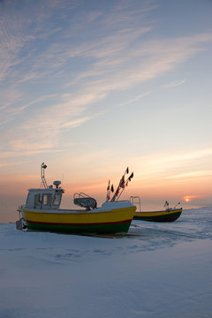 Podmorskie region, Poland - December, 2010: fishing boats on the beach in the winter, Baltic sea near Sopot town