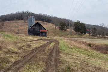 Vintage barn in large pasture with rolling hills