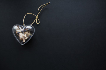 Valentines day background. Glass heart isolated on black.