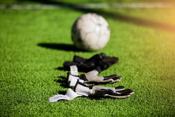 Goalkeeper gloves and football