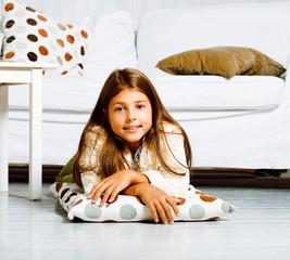 little cute brunette girl at home interior happy smiling close u