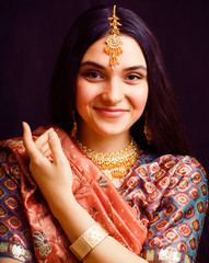 beauty sweet real indian girl in sari smiling, lifestyle people