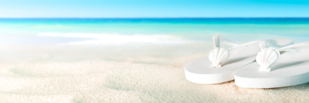 White Shells And Sandals On Sandy Beach With Tropical Water And Blue Sky - Beach Holiday Concept
