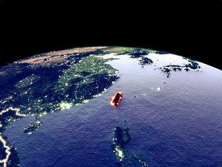 Taiwan from space on planet Earth at night with bright city lights. Detailed plastic planet surface with real mountains.