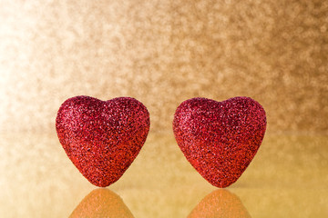 2 red hearts with gold background
