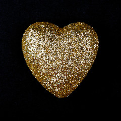 Gold heart over black
