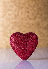 Red heart over gold background