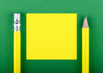 Yellow pencils on green