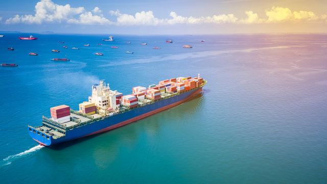 shipping container cargo business international inport ans export consumer product open sea aerial view