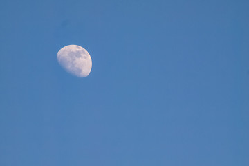 moon in evening time on beautiful natural blue sky background