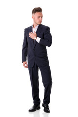 Full figure shot of handsome elegant young man with suit and neck-tie, isolated on white, looking at camera