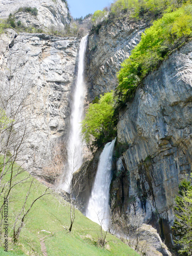 Wall mural two tall waterfalls in the mountains of Switzerland above Walensee