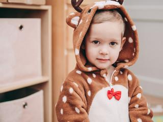 Young girl in animal like pajamas.