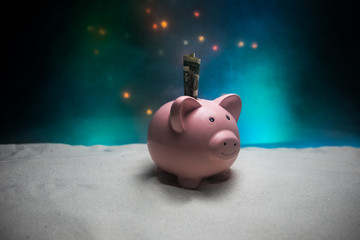Merry Christmas and happy New year. Chinese new year of the Pig, symbol 2019 for greetings card. soft selective focus. Toy pig in the branches of spruce. Pink pig on snow.