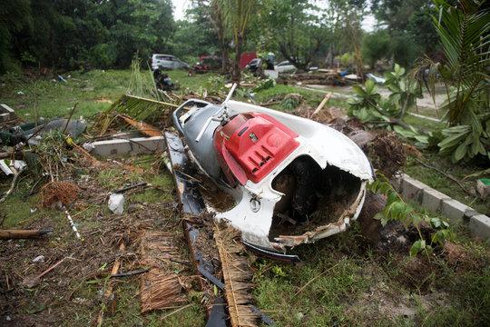 A broken jet ski is seen among debris after a tsunami hit Tanjung Lesung beach in Banten