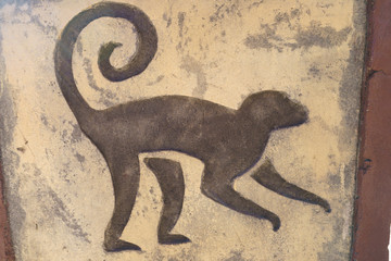 Monkey picture at the stone wall
