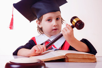 Judge gavel with Justice lawyers, humorous portrait of cute little child girl lawyer working in courtroom. Humorous photo.