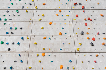 Outside free climbing wall on a light grey concrete surface in the center of Copenhagen, Denmark.