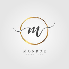 Elegant Initial Letter M Logo With Gold Circle Brushed