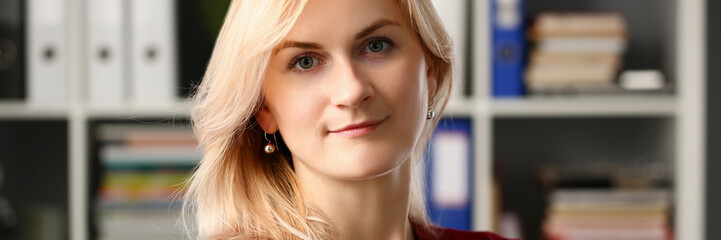 Normal blond woman portrait at office