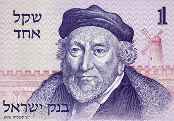 Sir Moses Montefiore face portrait on old Israeli 1 shekel (1980) banknote close up. Founder of Mishkenot Shaananim, the first jewish settlement of outside the Old City of Jerusalem.