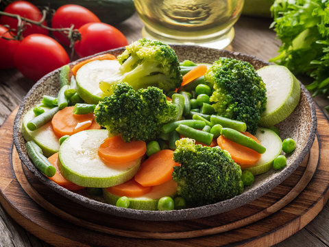 Mix of boiled vegetables, steam vegetables for dietary low-calorie diet. Broccoli, carrots, cauliflower, side view.