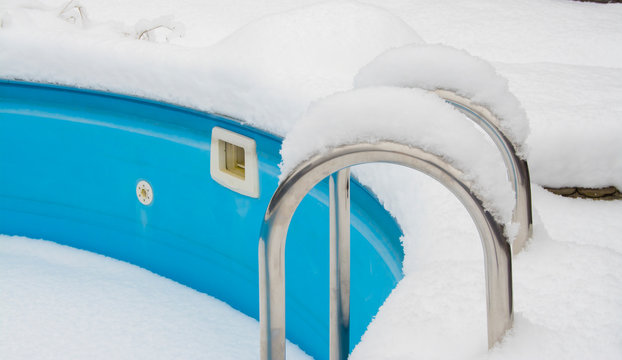 outdoor swimming pool in winter under the snow.